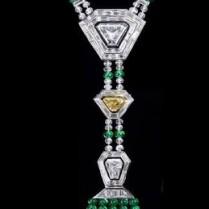 3.27 Trapezoid-shaped diamond, a 1.02-carat vivid yellow trapezoid diamond and a 1.59-shield-shaped diamond with emerald and diamond beads throughout (110.00ctw).