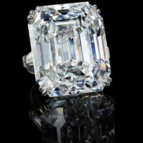 55.38-carat flawless emerald-cut diamond flanked by two tapered baguette diamonds mounted on platinum.