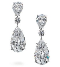 10.25-carat and 10.05 pear-shaped diamonds with 3.22-carat and 3.17-carat pear shaped diamonds, accented by round brilliant-cut diamonds in platinum.