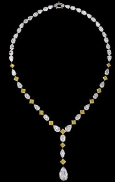 The diamonds used to create this piece include: A 6.52-carat pear shaped radiant drop, 15 radiant-cut fancy, vivid yellow diamonds (12.38ctw), with oval, pear-shaped and marquises (37.73ctw), accented with 12 baguettes (0.23ctw) mounted on platinum and yellow gold.