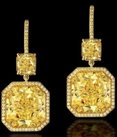 Two radiant-cut fancy yellow diamonds (15.49 carats and 15.27 carats) beneath two radiant-cut internally flawless fancy yellow diamonds (3.22ctw) accented by yellow melee and set on 18k yellow gold.