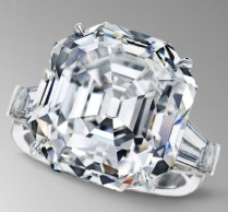 Platinum ring with 22.28-carat square emerald cut diamond, accented by 2 tapered diamond baguettes.