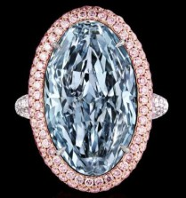 11.4-carat fancy, intense, blue, oval diamond surrounded by pink and colorless melee set on platinum and 18k rose gold.