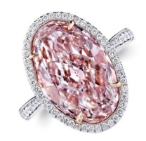 6.17-carat oval-shaped light-pink diamond surrounded by diamond melee and set on 18k pink gold and platinum.