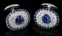 Oval sapphires (2.71ctw) surrounded by brilliant cut diamonds (1.92ctw) and 48 round sapphires (1.53ctw) set on platinum and 18k white gold.