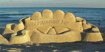 12. Have a professional sand castle builder, make a sand castle marriage proposal during a weekend at the beach.