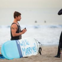 14. Propose on the beach! This couple's favorite thing is surfing.